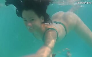 Nice ass Russian teen Rusalka gets naked and swims in the pool