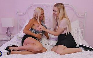 Teen blonde lesbians Dani Dare and Lena Spanks seduce each other
