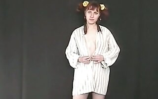 Pigtailed ginger nympho flashes her ugly pale tits and her pissing undertaking