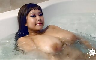 Asian babe with huge melons in burnish apply bathtube