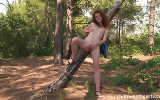 Curly ginger rubs pussy out secure the woods