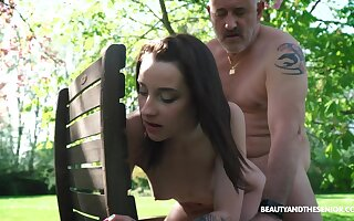 Nympho Charlotte Johnson is spying on naked superannuated neighbor in the garden