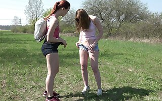Pussy eating between Charli Red and Kizzy Sixx in outdoors