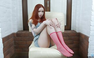 Ginger teen Lagoon Blaze is finger fucking pussy issuing legs unbarred
